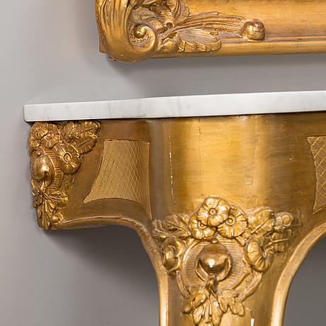 A neo rococo style mirror with a console table, first the half of the 20th century.