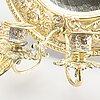 Spegellampetter ett par nyrenässans omkring 1900.