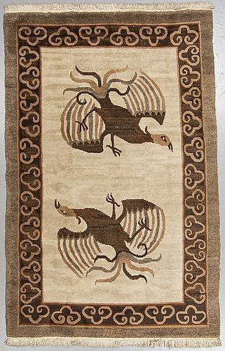 A rug, old tibet, ca 241 x 150 cm.