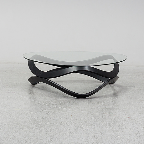 """A """"newton"""" coffee table designed by dan sunaga & staffan holm in 2009."""