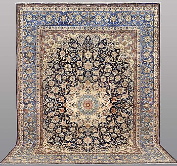 A CARPET, Kerman, signed ca 418 x 298 cm.