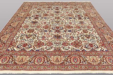 A carpet, tabriz, ca 398 x 287 cm.