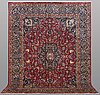 A carpet, mashad, signed, ca 385 x 293 cm.