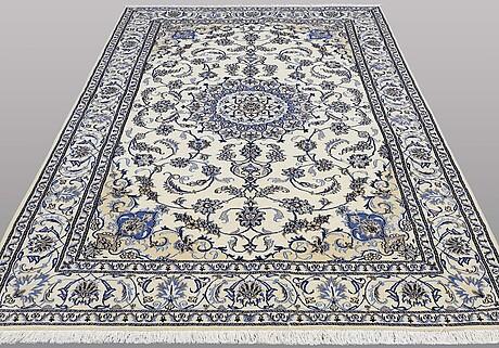 A carpet, nain, part silk, ca 300 x 198 cm.
