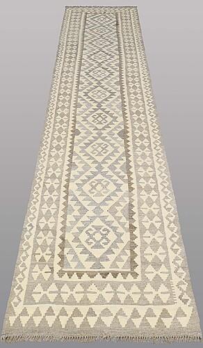 A runner, kilim, ca 382 x 85 cm.