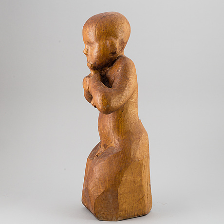Jan naliwajko, a large wooden sculpture of a child, signed and dated 1982.