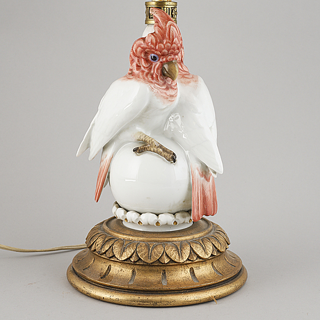 A german porcelain and wooden table lamp, 1930/40s.