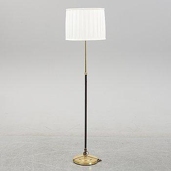 A brass and leather floor lamp from Örsjö Industri, 21st century.