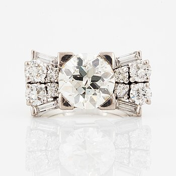A baguette cut and old brilliant cut diamond ring.