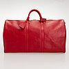A red epi leather keepall travel bag.