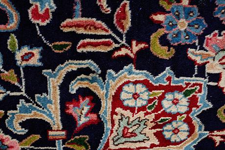 A carpet, a kerman, ca 407,5-410,5 x 295-297,5 cm, signed rashid koohi.