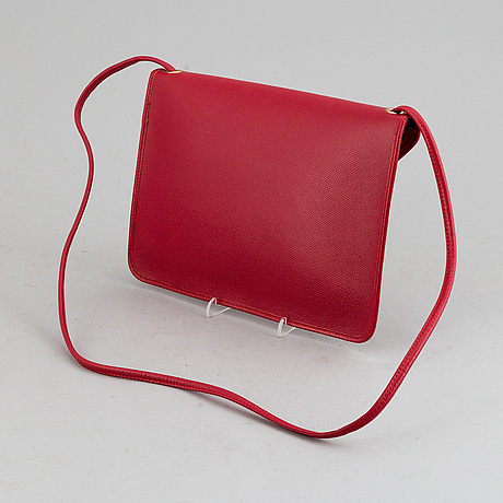 Yves saint laurent, a red leather bag.