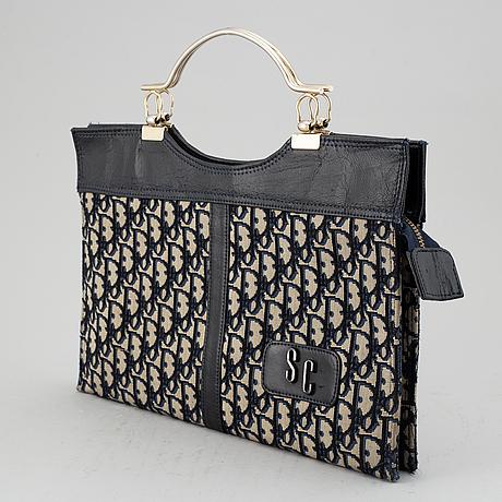 Christian dior, a monogram canvas handbag.