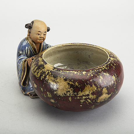 A japanese 20th century signed porcelain figurine.