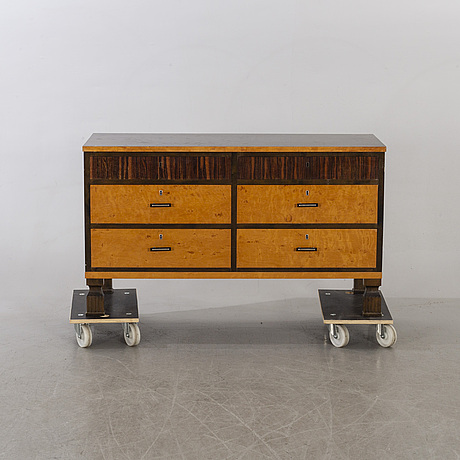 A swedish chest of drawers and a mirror, 1930's.