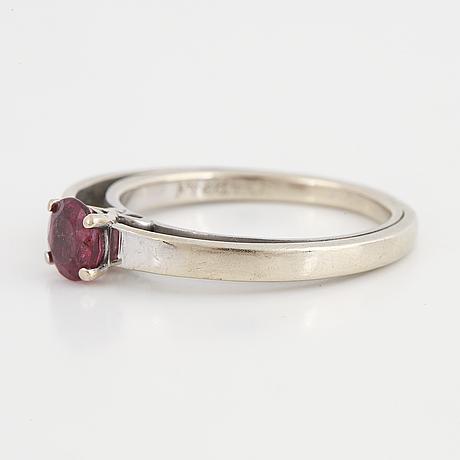 A tourmaline and brilliant cut diamond ring.