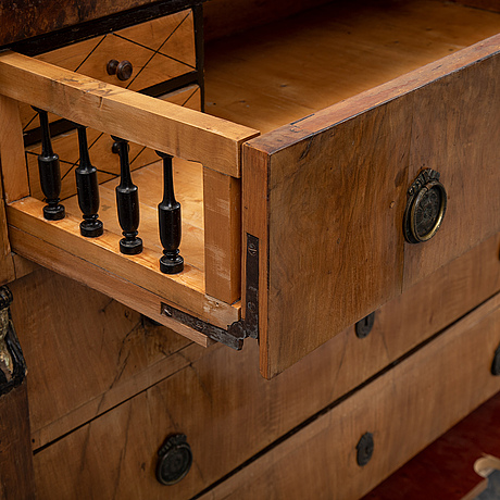A biedermeier chest of drawers, probably austria, first half of the 19th century.