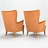 A pair of 1950's open arm chairs for oy paul boman ab.