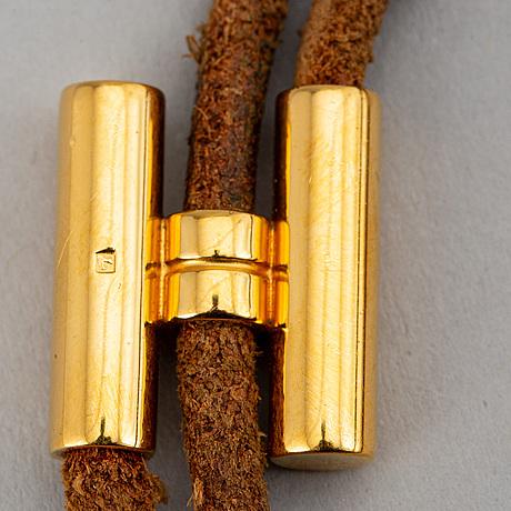 HermÈs, gold plated palladium h leather bracelet.