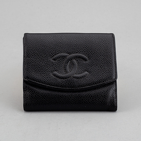 Chanel, a black caviar leather wallet.