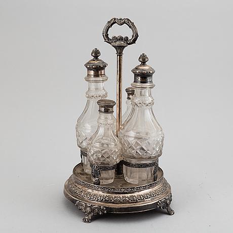 Bordssurtout, silver och flaskor i glas. jacob lenholm, stockholm 1835.