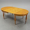 A mid 19th century birch dining table.