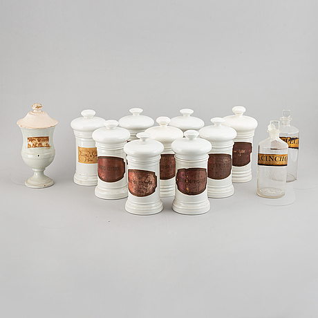 A group of 12 ceramic and glass pharmacy flasks/bottles, early 20th century.