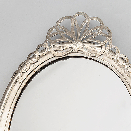 A russian possibly 18th century silver mirror.