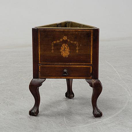An english mahogany veneered wine cooler, circa 1900.