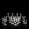 A mixed lot of eighteen 19th century empire wine- and champagne glasses.