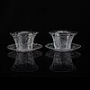 A pair of glass bowls with dishes, 20th century.