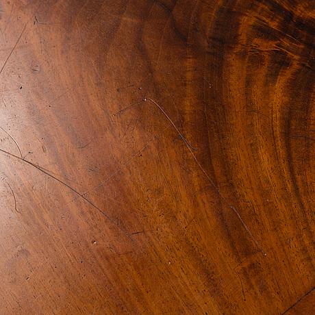 An early 20th century late gustavian mahogany veneered table.