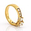 Ring 18k gold w brilliant-cut diamonds. 3 center stones approx 0,70 ct in total.
