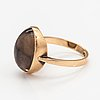 A 14k gold ring with a smoaky quartz.