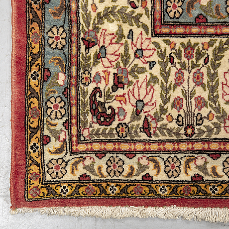 A carpet, semi-antique qum, ca 341 x 238 cm.