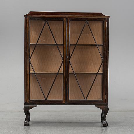 A walnut veneered cabinet, first half of the 20th century.