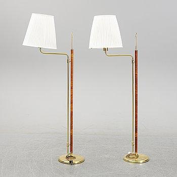 A pair of brass and leather floor lights, Örsjö industri, 21st century.