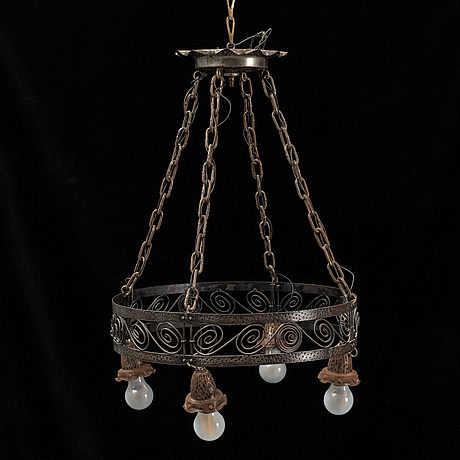 An iron ceiling light, early 20th century.
