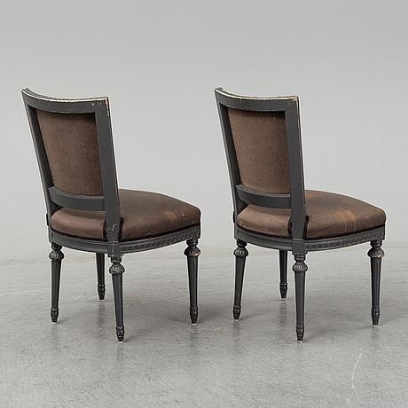 Twelve mid 20th century gustavian style chairs.