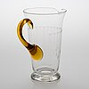 A glass pitcher with six glasses from around the 1920s.