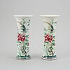 A pair of famille rose vases, qing dynasty, 19th century.