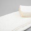 A linen tablecloth and 21 linen napkins.