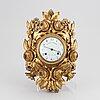 A gilt wall clock, daniel thunberg, af edlund, stockholm.