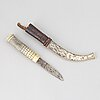 A sami reindeer horn knife, signed aw and dated 1931.