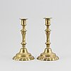 A pair of candlestick, brass, france 18th century.