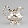 A russian 19th century parcel-gilt silver cream-jug, mark of abraham forstedt, st. petersburg 1840.