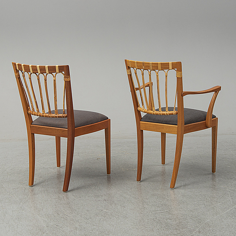 A set of two armchairs and six mahogany and rattan dining chairs, josef frank, model 1165, svenskt tenn, stockholm.