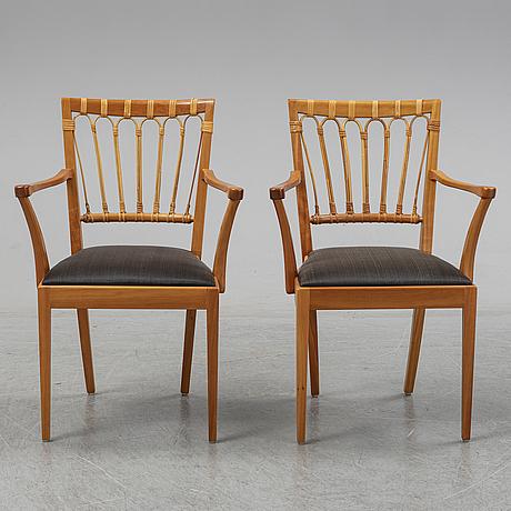 A pair of mahogany and rattan dining armchairs, josef frank, , model 1165, svenskt tenn, stockholm.