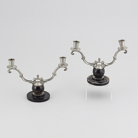 A pair of 1930s pewter and wood candelabra.
