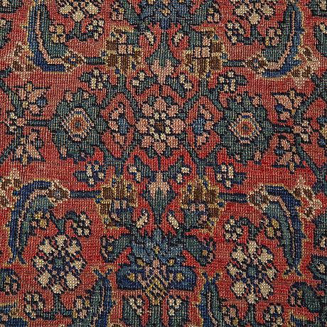 A rug, an antique bidjar, ca 220-228 x 138-141 cm.